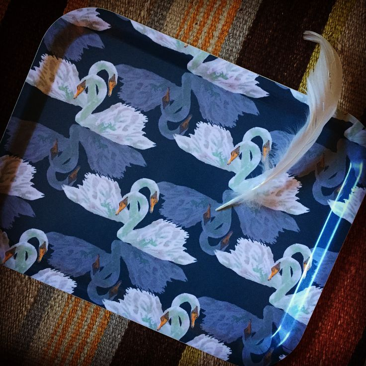 """""""Bibury"""" swan design tray £20. This smart serving accessory is a beautiful choice to bring colour and pattern to any home. Featuring original The Humble Cut potato printed artwork they are extremely durable and dishwasher safe up to 95ºC. Handmade in Sweden from birch veneer. Size 36 x 28cm #tray #servingtray #swans"""
