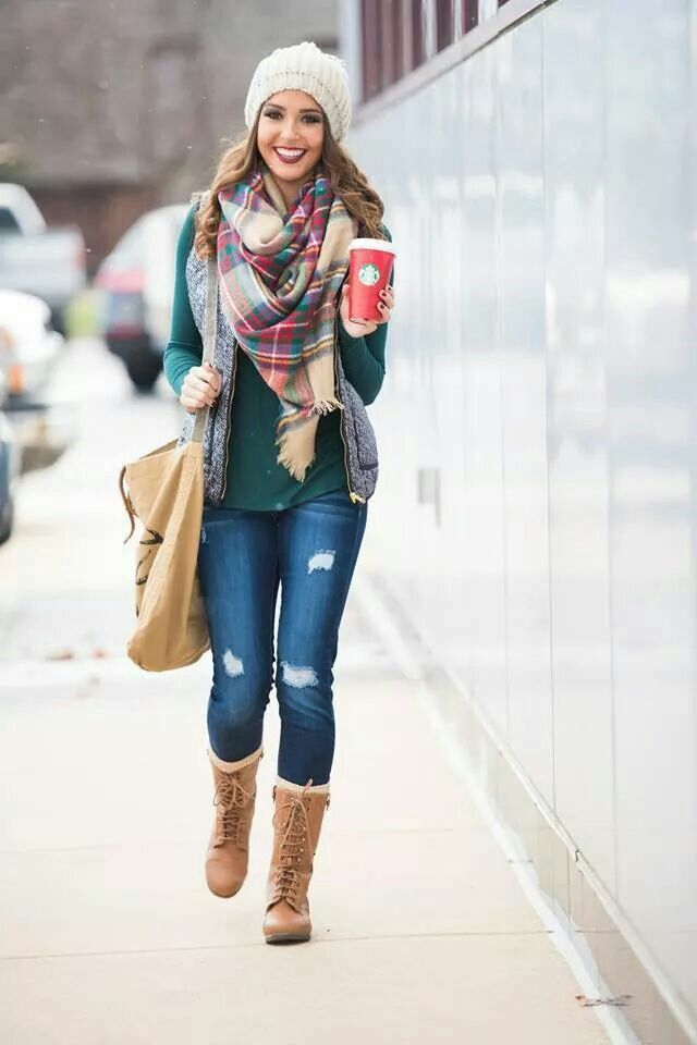 Team a grey quilted vest with blue ripped slim jeans to achieve a chic look. Grab a pair of tan leather knee high boots to instantly up the chic factor of any outfit.  Shop this look for $166:  http://lookastic.com/women/looks/beanie-scarf-vest-long-sleeve-t-shirt-tote-bag-skinny-jeans-knee-high-boots/6461  — White Beanie  — Red and White Plaid Scarf  — Grey Quilted Vest  — Teal Long Sleeve T-shirt  — Tan Canvas Tote Bag  — Blue Ripped Skinny Jeans  — Tan Leather Knee High Boots