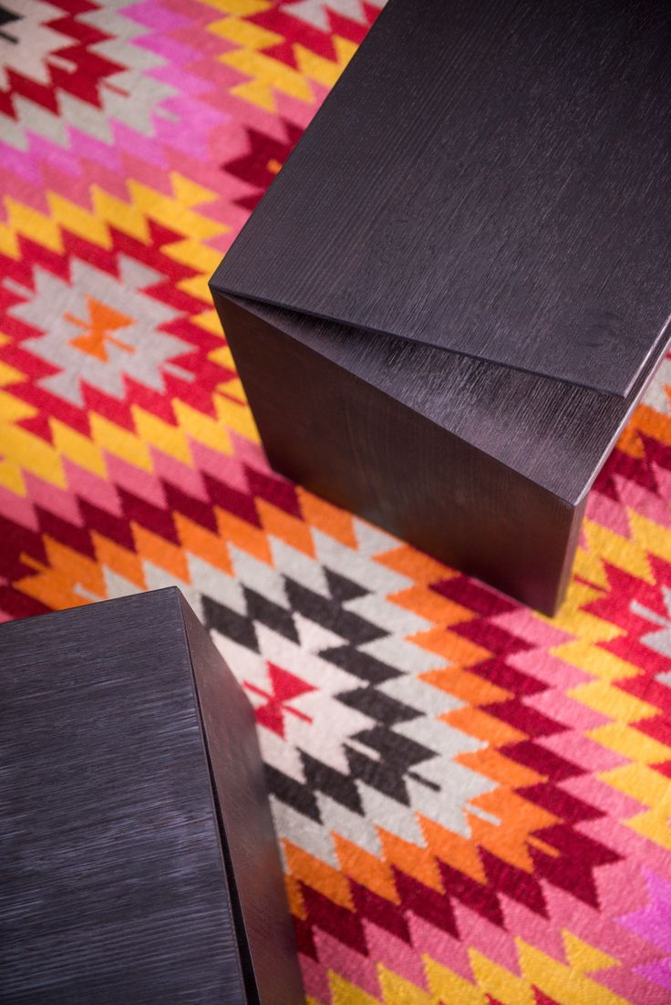Clipped wing torched benches and Armadillo and Co Caravan rug