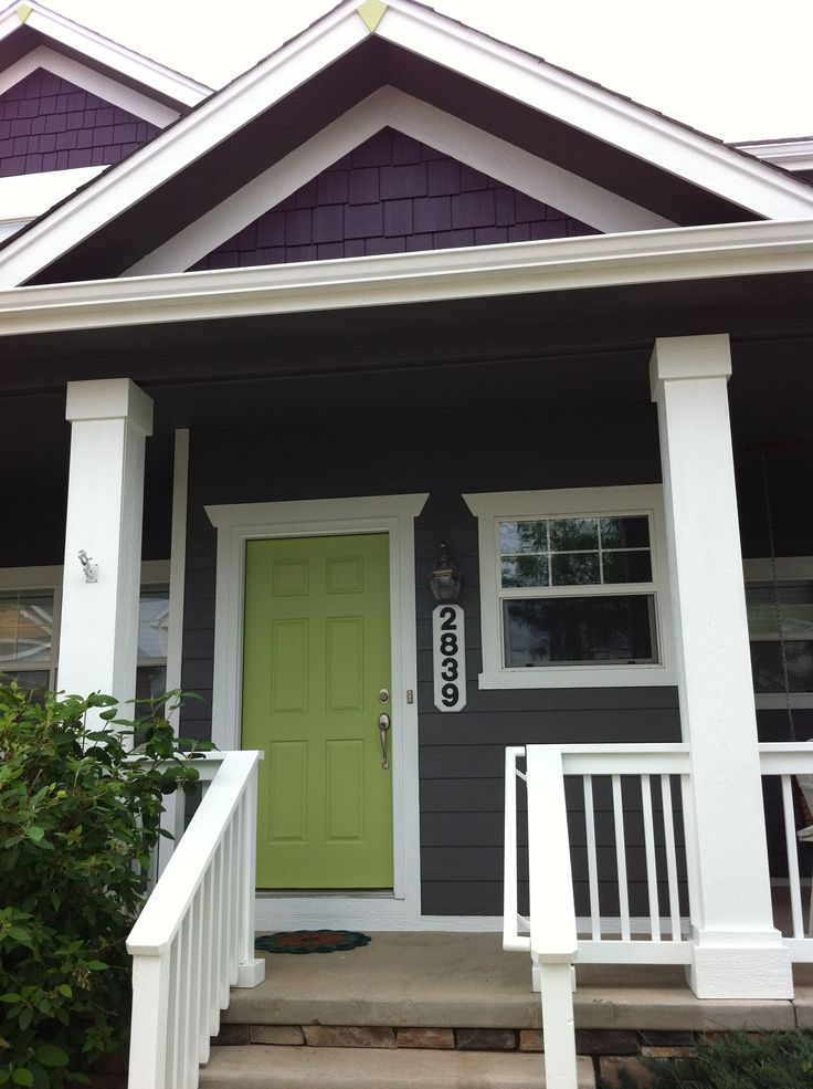 Exterior House Color Eggplant   With Bright Green Door.