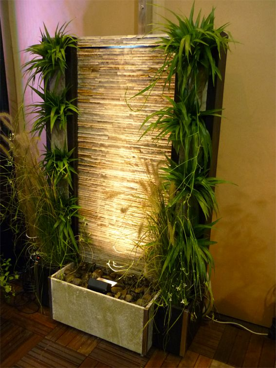 Fountain by Cactose, made of natural black and white stone with plants and light.  www.cactose.fr