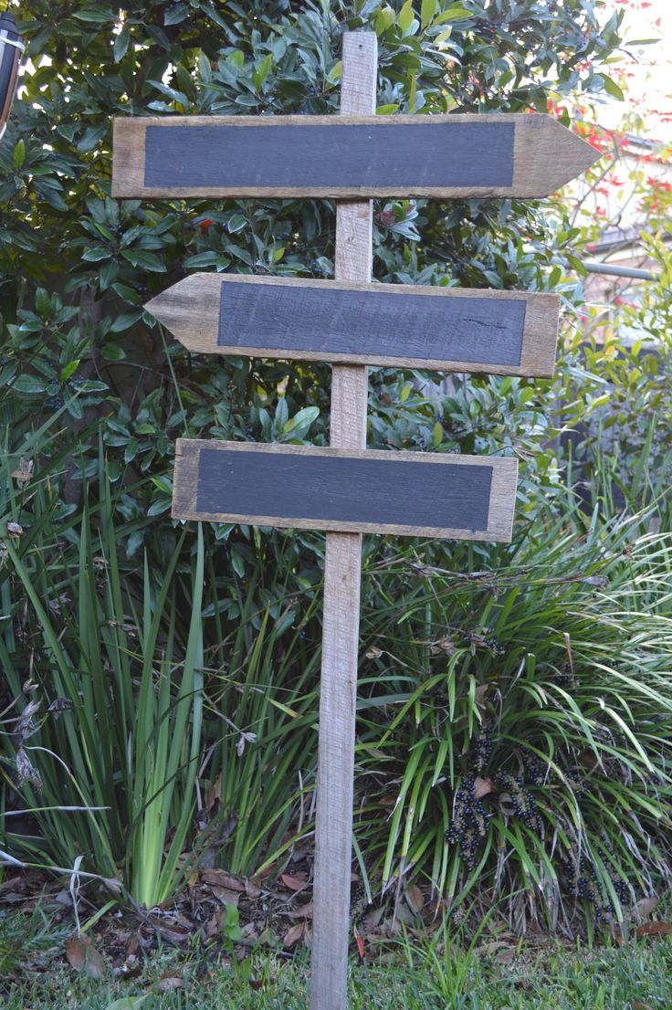 DIY chalkboard directional wedding sign. Rustic country style #queenstvintage #rusticprops #rusticweddings #recycledtimber #prophiresydney #vintageideas #rusticsigns #rusticdrinkstations #rusticsweettables #vintageweddings #rusticwishingwells #timberweddingsigns #drinkstations #photobooth #tablecentrepieces #caketables