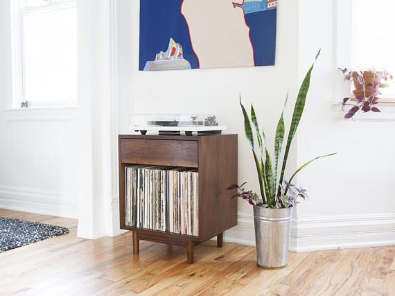 Mid Century inspired record cabinet with high quality soft close drawer. Designed for those looking for a compact stylish way to store their records and turntable. Made with hardwood and real Walnut veneer. Premium Blum© soft close drawer slides. Finished with low VOC water based