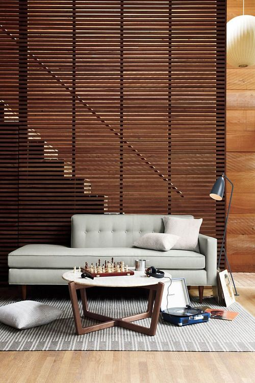 Modern stairs with a slatted Partition.