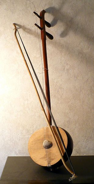 """The đàn gáo (""""coconut shell lute"""") is a bowed string instrument, a part of the traditional Vietnamese orchestra. It is similar to the đàn hồ.[1] The instrument originated from South Viet Nam, and is used in entertainment contexts. It can be played alone, as part of an orchestra, or to accompany cải lương (Vietnamese folk opera). Tập tin:Dangao.jpg"""