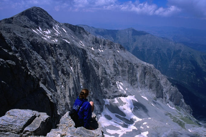 Mt Olympus, Greece  Trekker resting beneath western face of Mytikas on Mt Olympus. Lonely Planet Media  Mark Daffey Lonely Planet Photographer