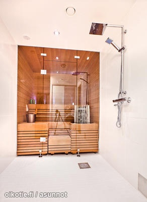 Glass front to sauna used as shower wall