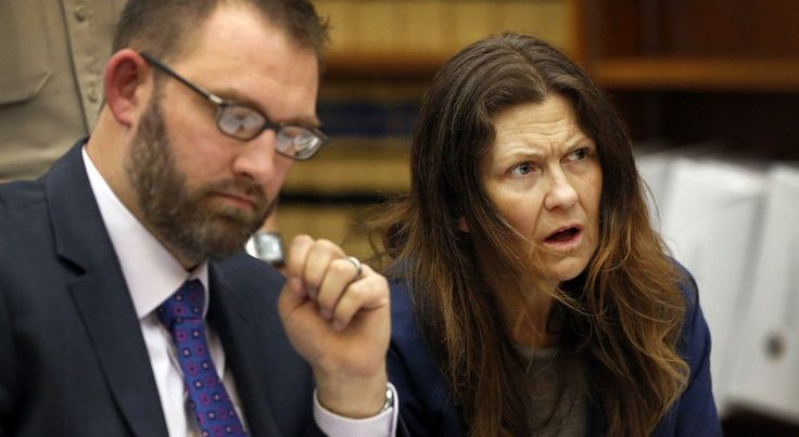 Defense attorney Brian Schmidt and his client, Theresa Owens listen as a prosecutor speaks during Owens' sentencing hearing at the downtown San Diego Superior Court.