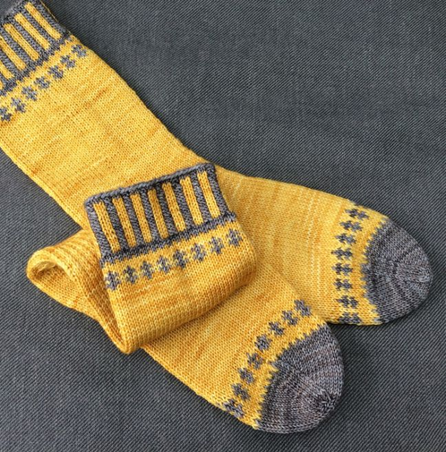 (Photos: Deborah Kemball) These gorgeous socks were just published to Ravelry this week and are designed by one of our very own customers! Self-Important Socks by the lovely Deborah Kemball are kni…