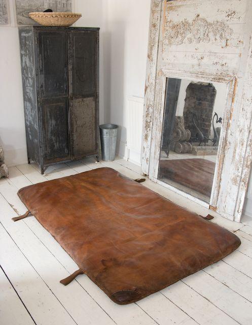 Leather gym mats make an interesting rug.