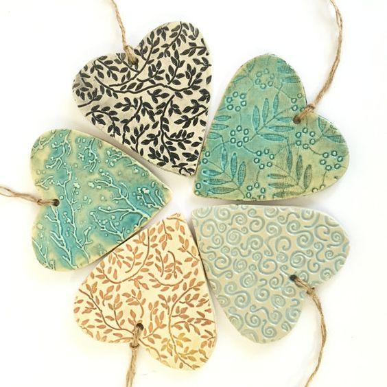 Ceramic Heart Ornament, pressed lace heart ornament, imprinted love ornament, Christmas heart ornament, lace pottery.  This is a heart shape handmade wall décor, made of clay and glazed with a unique turquoise color. There is a gorgeous and delicate lace impression on it. The wall décor attached to a Suede-like string. Length 3.5 width 3.5 thickness 0.4  For more ceramicheart shape wall décor: http://etsy.me/2jxhm8K  For more ceramic wall décor: http://etsy.me/2j...: