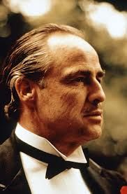 "Marlon Brando, Jr. -- (4/3/1924-7/1/2004). American Actor, Film Director & Activist. Movies -- ""On the Waterfront"" as Terry Malloy, ""Guys and Dolls"" as Sky Masterson, ""The Ugly American"" as Ambassador Harrison Carter MacWhite, ""The Godfather"" as Don Vito Corleone, ""Superman"" as Jor-El, ""Apocalypse Now"" as Colonel Walter E. Kurtz, ""The Fugitive Kind"" as Valentine 'Snakeskin' Xavier, ""The Freshman"" as Carmine Sabatini. He died of Respiratory Failure, age 80."