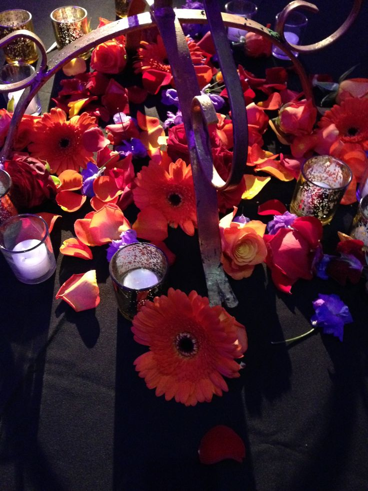 Orange and Purple Vibrant Flowers made a pretty addition to the gorgeous centre pieces on each table