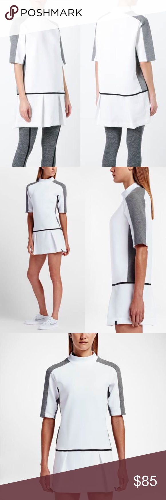 White Nike Dress White Nike dress with grey trim sleeves and drop waist. I think it's meant for tennis but is cool enough to pass as streetwear. Thick athletic polyester blend fabric. New with tags! Nike Dresses Mini