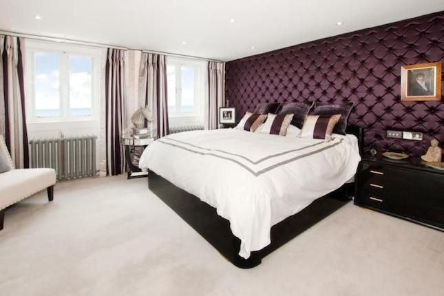 This sumptuous deep purple padded wall add glamour and comfort to this glamourous bedroom. #primelocation