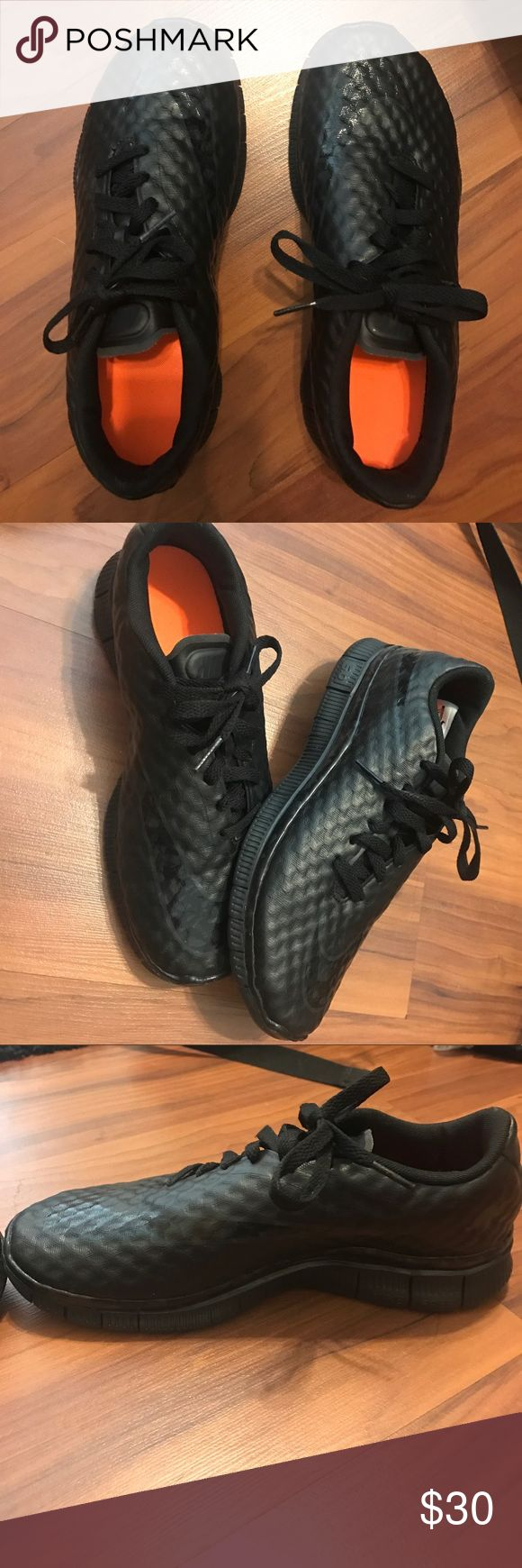Black nike running shoes only been worn twice All black with orange on the inside. Laces are off centered with a black textured look on the outside. Nike Shoes Athletic Shoes