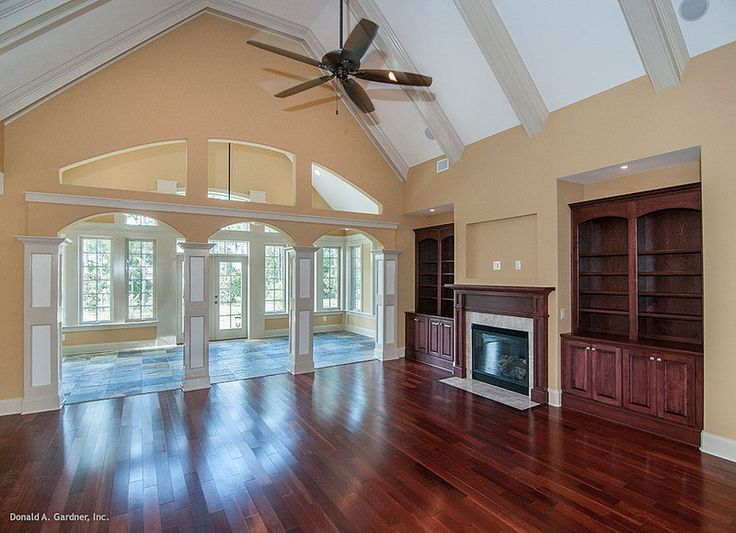 This Great Room Features Built Ins A Fireplace And A