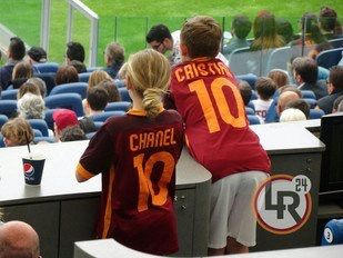 Chanel and Cristian Totti watching their father and AS Roma