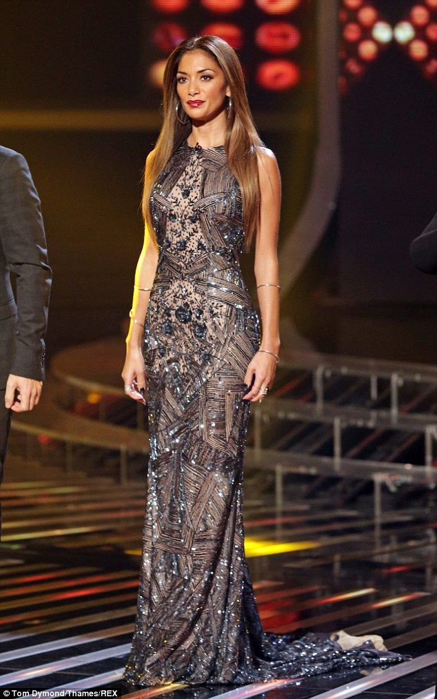 Beady eye: Nicole Scherzinger dazzled in another show stopping dress on the X Factor on Sunday night