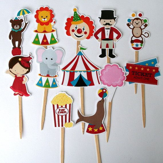 Assorted Circus or Carnival Cupcake Toppers    This listing is for 12 totally adorable striped circus cupcake toppers!    There are 12 different circus/carnival images, you will receive 1 of each (ringmaster, seal, circus tent, popcorn, circus girl, lion, tickets, elephant, bear, clown, cotton candy, and juggling monkey) unless otherwise specified. These toppers are all between 1.75-3tall. The picks used to create these cuties are non-toxic and food-safe. These cupcake toppers are…