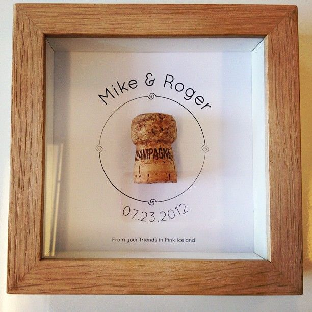 Cute idea for a keepsake - frame the champagne cork with names and date... this would be super cute for near the wine cabinet
