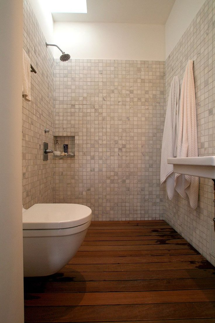 open shower with pitched floors so the entire room drains. high toilet.