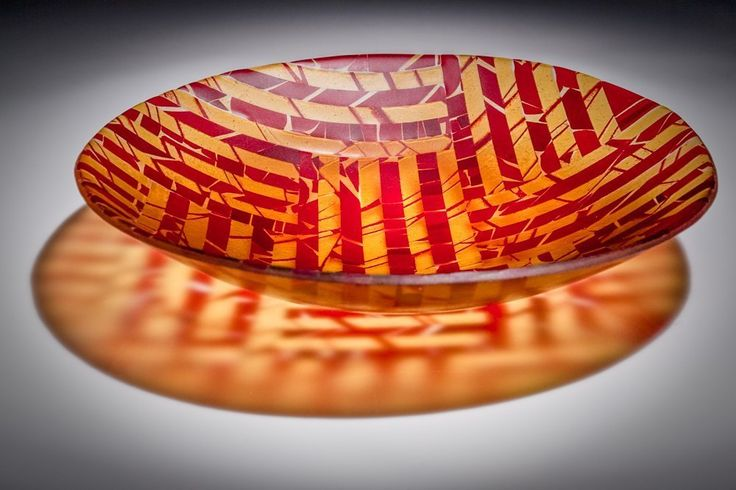 sunset art glass bowl. Fused and slumped glass bowl in in amber and orange. Sheets of art glass are created and fired, then cut and assembled to create this stunning bowl perfect for a centrepiece in your home. Sandblasted to create a satin finish. Size and color may very slightly. Hand wash with mild soap and warm water.