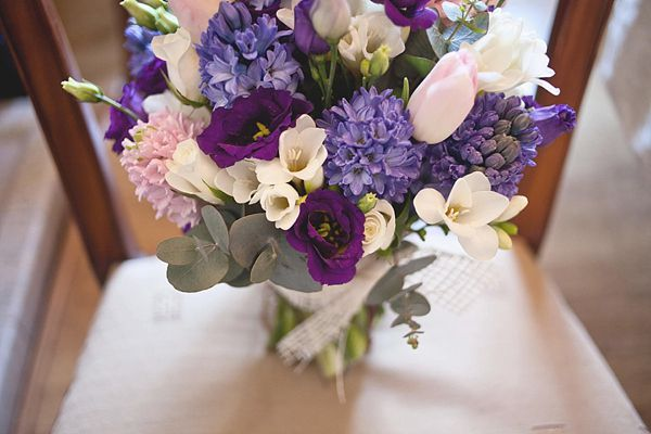 Purple and ivory bridal bouquet. Photography by www.sallytphotography.com