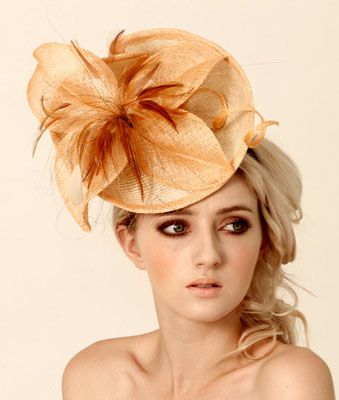 Judy Bentinck Under The Rainbow Peach Parisisal Sculpted Headpiece with hackle feathers mounted on a broad headband.