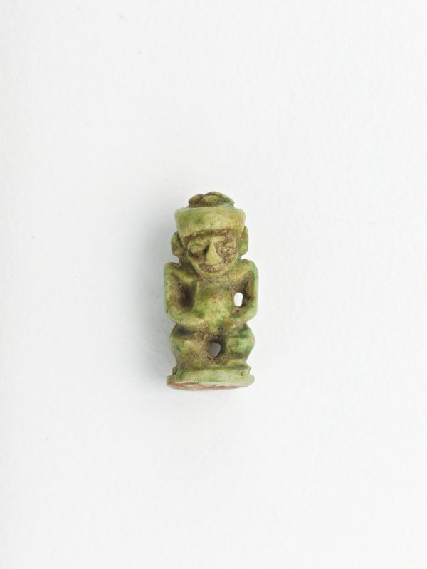 Amulet in the form of a standing figure of Bes    TYPE  Amulet  HISTORICAL PERIOD(S)  Possibly Ptolemaic Dynasty, 305-30 BCE  MEDIUM  Clay  DIMENSION(S)  H x W: 1.4 x 0.7 cm (9/16 x 1/4 in)  GEOGRAPHY  Egypt