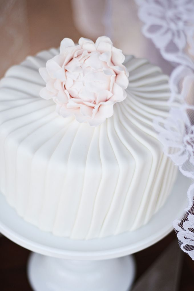How pretty is this cake made by my friend Joanna? She made this gorgeous pleated cake topped with a powder pink sugar flower for her 10 year wedding anniversary! See more on The TomKat Studio