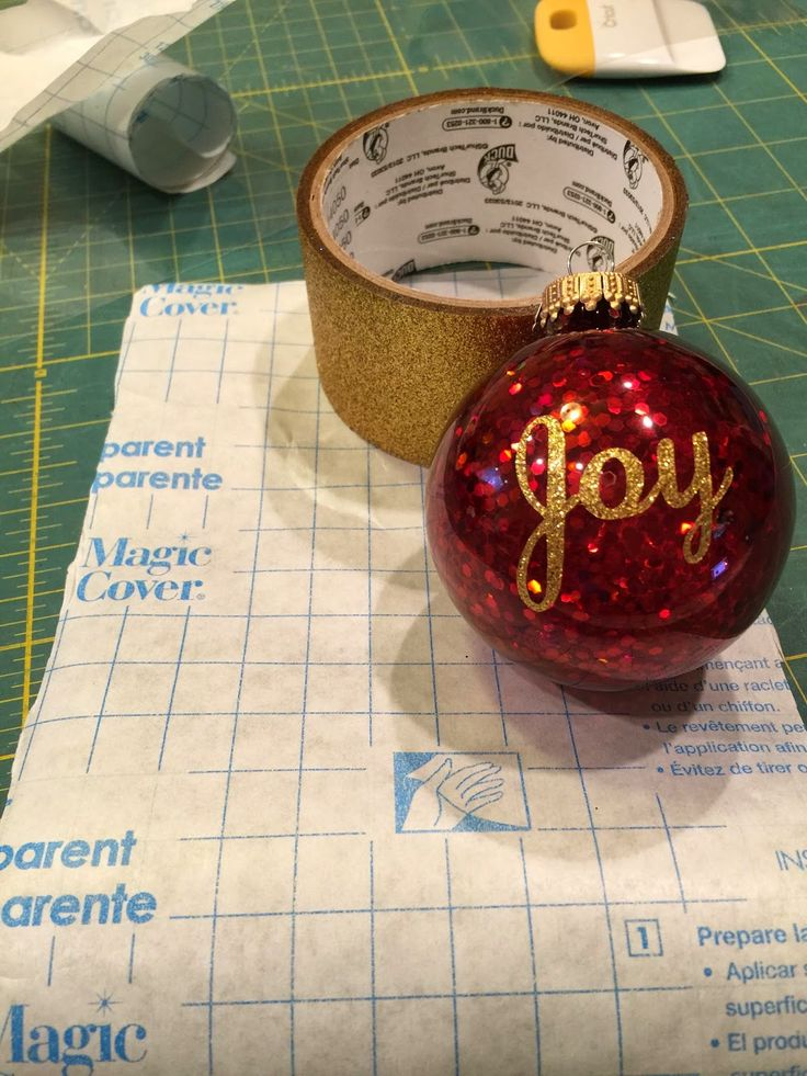 I recently wanted to add lettering to some ornaments, but could not find the vinyl desired locally. I had silver, but not gold...But I did find Duck Tape.Yup, the Duck tape is on a roll! But it was PERFECT! The ornaments were glittered from Wal-mart--done! And the stuff with the blue squares...that
