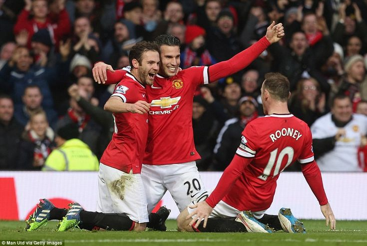 Wayne Rooney slides in to join his fellow goalscorers Juan Mata and Robin van Persie after...
