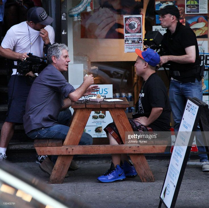 Chef, restaurateur, author, and TV personality Anthony Bourdain and chef and restaurateur Eddie Huang are seen at BaoHaus NYC on June 28, 2011 in New York City.