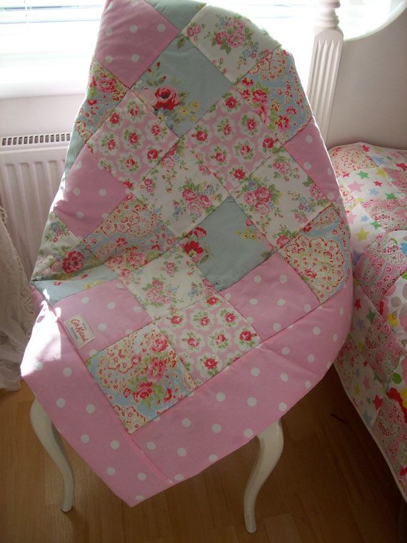 This Shabby Chic cot or cot bed quilt is handmade from a selection of 5 Cath Kidston Fabrics.