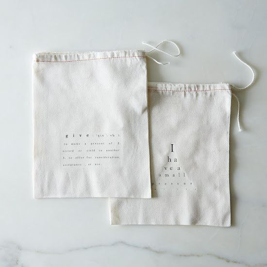 """unbleached cotton drawstring bags printed with the definition of give and an eye chart """"i have a present for you....""""  great for wrapping small presents and for reusing over and over. bags are 8 x 9.5"""" (20 x 26 cm ) in size."""