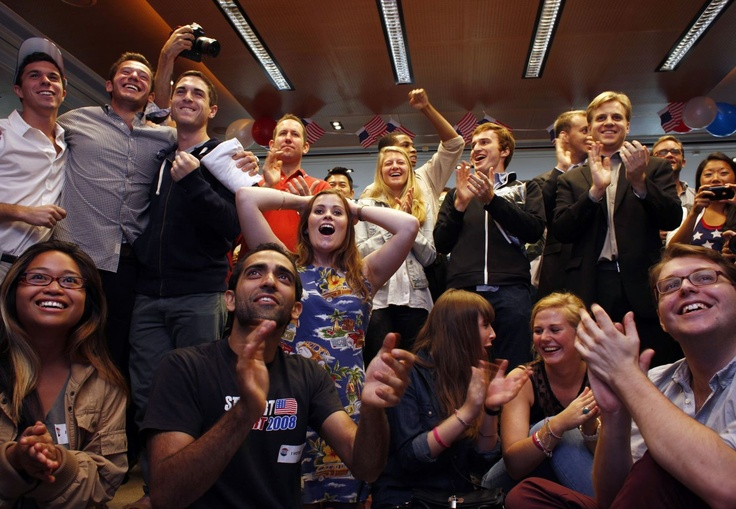 Supporters cheer as a TV broadcast announces an exit poll result which shows Barack Obama to win re-election, during a function held in Hong Kong