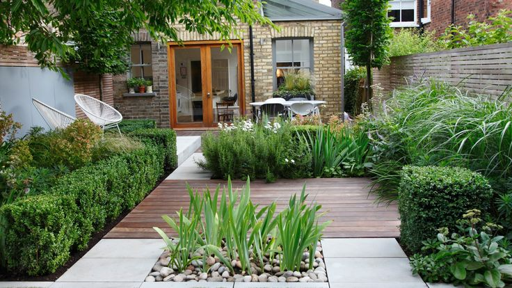 This architectural garden features decking, paving and plants to create different zones