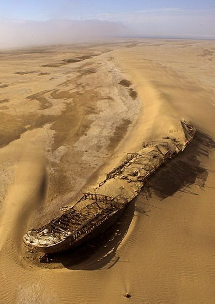 Skeleton Coast, Namibia. The ship that ran aground off the coast of Namibia's Skeleton Coast on September 5, 1909, in a thick fog. Currently the wreck lies in the sand a distance from the shoreline.