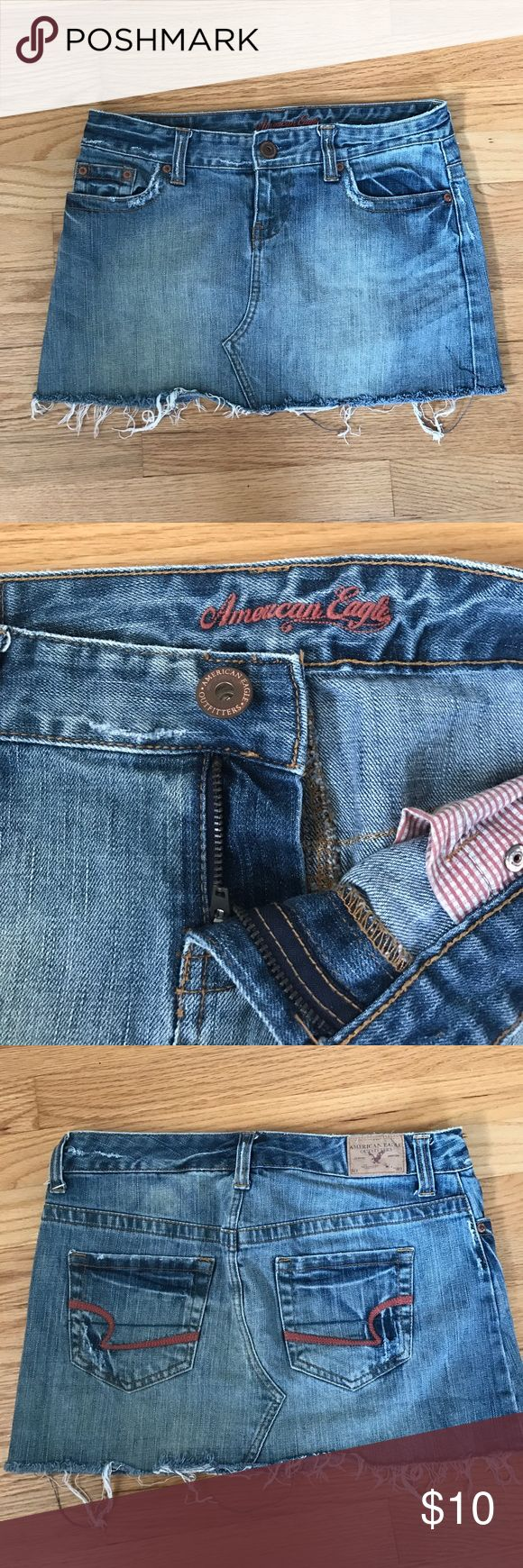 """Like New Distressed American Eagle Jean skirt Like new American Eagle distressed denim skirt. Gently worn but great condition - skirt design is made to look """"worn"""" or """"distressed"""" with hanging fringe and faded areas and slight intention rips around pockets etc. Size 4 American Eagle Outfitters Skirts Mini"""