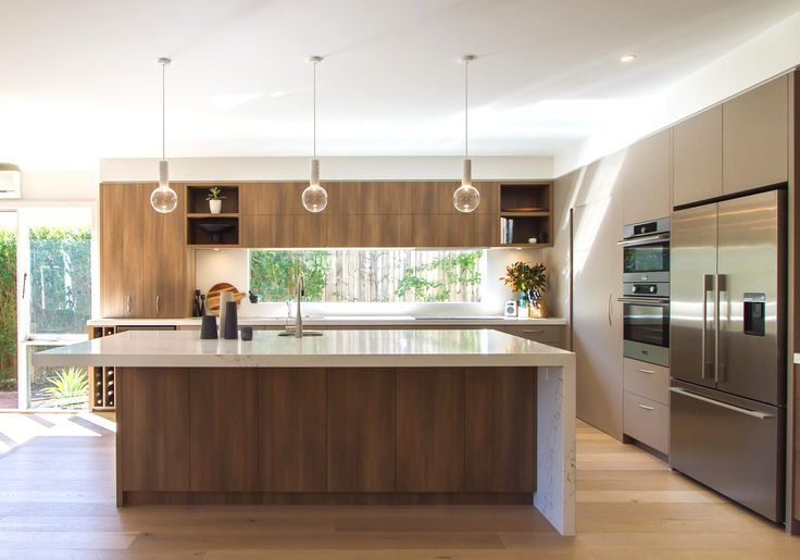 Large, modern, contemporary kitchen in warm tones with a huge island bench! www.thekitchendesigncentre.com.au @thekitchen_designcentre