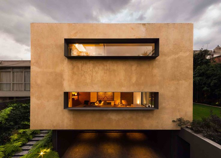 Carpinos House; Mexican architecture; big window for rooms; black frame; corten steel for brise soleil