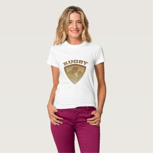 "Rugby player shield metallic gold tee shirts. Rugby World Cup women's t-shirt showing an illustration of a rugby player running passing the ball on isolated background done in metallic gold style set inside shield with words ""rugby"" #rwc #rwc2015 #rugbyworldcup"