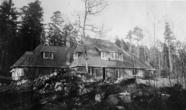 """Dola Dunsmuir lived in her house """"Dolaura"""" from the 1940s through until her death in 1966. The house was located between Hatley Park and Fort Rodd Hill in Victoria. It has since been torn down.  """"Dolaura before garden McCann Collection RRU Archives"""""""