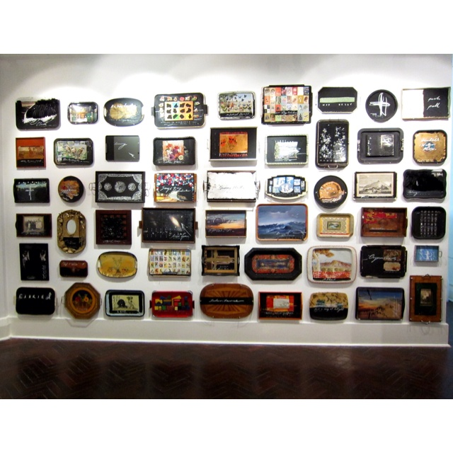 A fantastic wall of re appropriated breakfast trays! Artist: peter james smith http://www.flg.com.au/Exhibitions/Exhibitions2012/Time.html