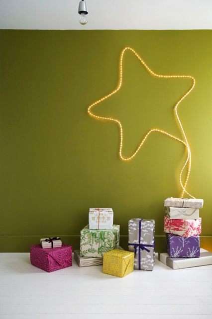 Simple to achieve and highly effective, this is the year to try a stylish light display. It needn't be limited to this star design, you could add the silhouette of a tree or even write a Christmas-related word on the wall.