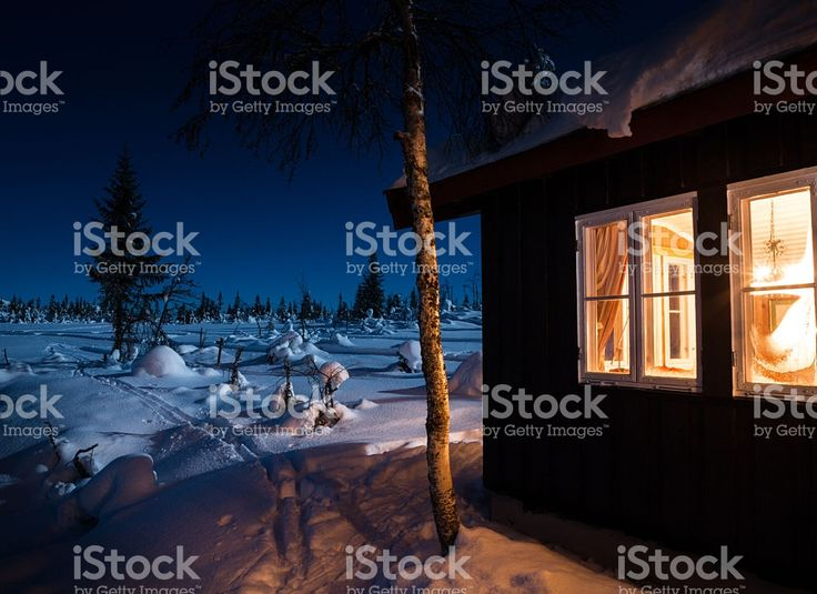 Mountain cabin at night with moonlight in January, Norway royalty-free stock photo