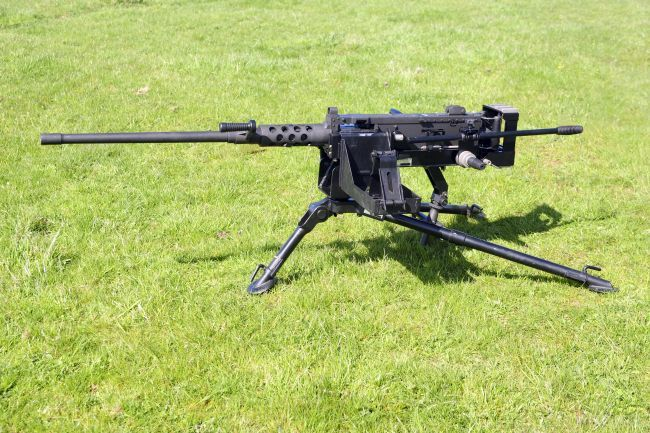 Browning M2 .50 caliber heavy machine gun...awesome weapon and the source of the most famous shot by Carlos Hathcock but not sure about the tripod pictured...not the M192 or 72 so a bit unsettled on how high the gun rests