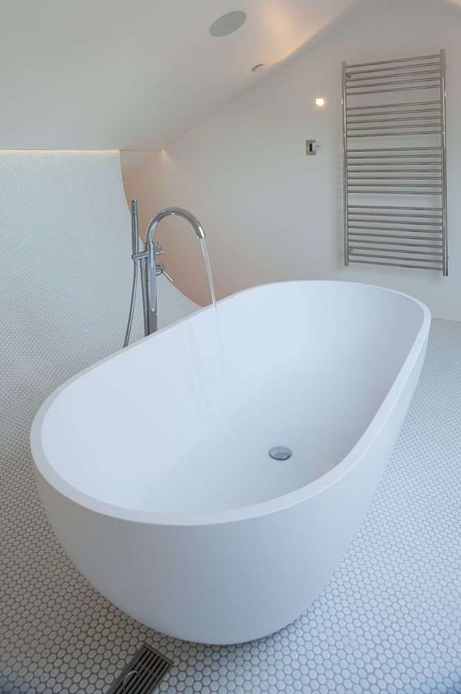 beautiful lighting for a clean white contemporary bathroom