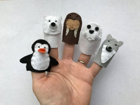 Go on a polar adventure with these adorable felt finger puppets! This set* of 5 puppets are hand-sewn original creations made with eco-friendly felt and thread!   *Please allow for minor variation between sets as these are hand-crafted items and will not be exactly the same.